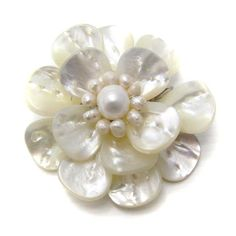 This brooch is a cute accessory to accentuate any style. This pin or brooch from Thailand, features natural mother of pearl with freshwater white pearl center stone.