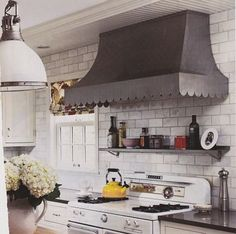 Give your kitchen a facelift by replacing the hood.  Add subway tile and a shelf that matches the hood and voila!!!, a whole new look for your kitchen :)