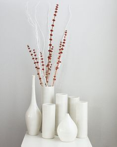 Handmade white porcelain pottery ceramic cylinder vase. Wheel thrown porcelain vase glazed in splashes of bright white. This glaze has a very subtle, two-tone look which gives the surface a bit of depth. It pairs beautifully with other white cylinder vases - especially for holiday displays or centerpieces. Its also the perfect container for a few long branches or flowers. This cylinder vase measuring approximately 2 1/2 wide x 8 3/4 high. Please note that due to monitor differences,...