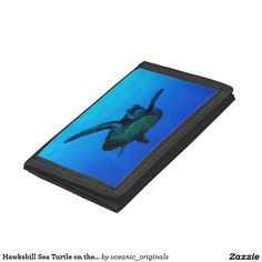 Cool wallet featuring a close up view of a Hawksbill Sea Turtle swimming out in the open in the clear blue waters of the Coral Sea on the Great Barrier Reef off the coast of QLD, Australia.