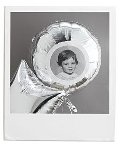 Martha Stewart Birthday Party  Picture Personalized Birthday Balloons:   Use spray adhesive to attach photos (use photo-editing software for round, white borders) to Mylar balloons.