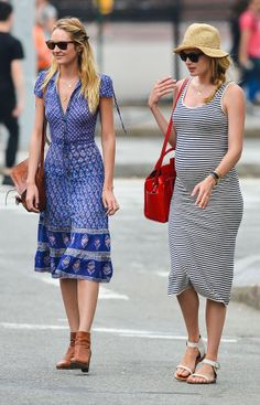 Doutzen Kroes showed off her baby bump while out with fellow Victoria's Secret model Candice Swanepoel.