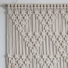 This macrame wall hanging is handmade using 100% cotton cord (4.5mm) in natural ecru with a bamboo supporting rod. Dimensions > Width: Approx. 50cm / 19.5 inches Length: Approx. 94cm / 37 inches This design can also be made in white (pure white) or black - please send me a message to
