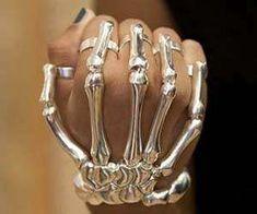 In fashion news, the finger-fitted skeletal bracelet...