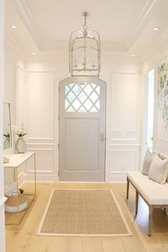 If You Love White Decor, This Home Will WOW You. What a stunning foyer entryway, soft colours, lovely hanging light fixture, upholstered bench and console table. Front Door Colors, Front Door Decor, Entryway Decor, Front Doors, Entryway Stairs, Exterior Stairs, Exterior Doors, Entryway Hooks, Hallway Bench