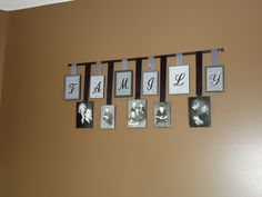 Family Picture Display! I Created this using 6-5x7, 5-4x6 frames, black and gray ribbon, iron on letters, and scrapbooking paper. The frames were super cheap from Wal-Mart only .95 each! The rod was from a curtain rod that I no longer needed.