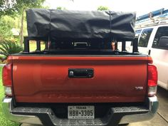 TPT Toyota Tacoma overland tent deck rack from the rear. 2016 Taco, bolts into factory cargo track.
