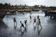 Boys playing football, Sittwe, Burma, 1994, photograph by Steve McCurry.