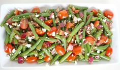 The Garden Grazer: Balsamic Green Bean Salad  1 lb. green beans,1 cup cherry tomatoes,1/2 small red onion,  Feta cheese  Dressing  2 Tbsp. each  balsamic vinegar,lemon juice,olive oil  1-2 cloves garlic, minced  Salt/pepper  Make the dressing: in a small bowl, whisk together all dressing ingredients.  Trim ends off green beans and rinse. Steam (or boil) for about 3-4 minutes until crisp-tender. In a colander, rinse well with cold water to stop cooking, then pat dry. Cut green beans
