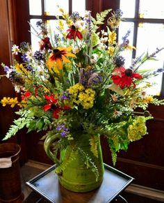 summer flower arrangements | Wild Flower Arrangement in Green Pitcher