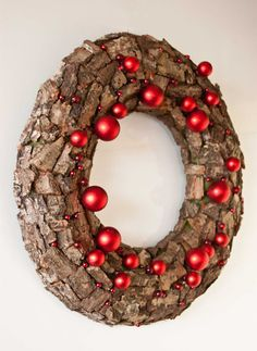 This holiday door wreath decorated with oak bark and different red beads and Christmas ornaments. Wreath will be great decoration for your door during