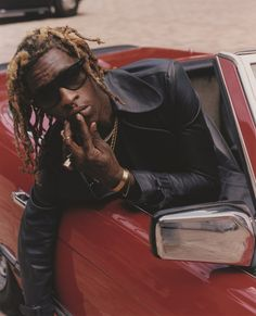 Leather trenchcoat J.W. Anderson, jewellery and sunglasses Young Thug's own, Photography Harley Weir, styling Robbie Spencer