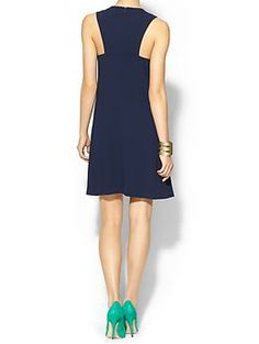 Love the cut of this navy cocktail dress by Trina Turk.