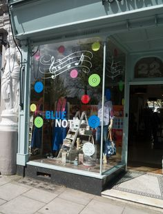 Jazz Festival window display in most beautiful shop in Cheltenham!