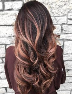 Layered Hair with Rose Gold Streaks