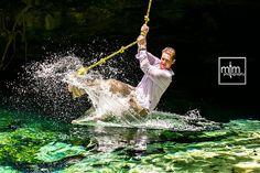 Cenote Trash the Dress....swinging thru cenote waters in Tarzan-style, splish-splash!!! MTM Photography in Mayan Riviera Wedding Photographer. Wedding Photographer photos in Cancun, Playa del Carmen, Puerto Morelos, Puerto Aventuras and Tulum. www.MomentsThatMatterPhotography.com