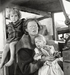 Poverty causes a mother to use an old Coca-Cola bottle as a baby bottle for her children, California, 1939