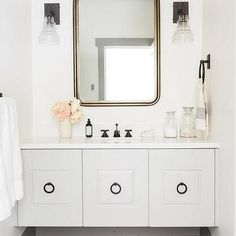 Pale Gray Floating Sink Vanity with Bronze Ring Pulls