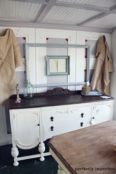 Beautiful piece. White painted buffet with stained top.