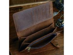 """PRODUCT DESCRIPTION Material: Genuine Leather Size: 7.3"""" x 3.5"""" x 1"""" inches Color: Brown Color Gender: Mens Style: Biker Wallet, Card Holder, Organizer - Inside 2 big bill compartments, 6 card slots,"""
