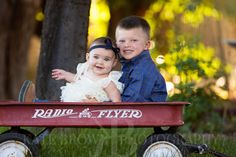 Western Photographer in Northern Nevada. Rustic family session at the Brown Ranch. Little Cowboy.Little red wagon.