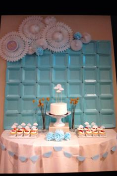 Wall decor(backdrop) at a shower for a baby boy using square paper plates