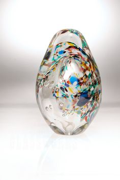 Matt Salley created this large egg sculpture full of vibrant colors and forms. The hot glass the consistency of honey at 2200 degrees. He