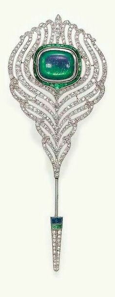 AN ART DECO OPAL AND DIAMOND JABOT PIN Designed as a openwork single-cut diamond feather, centering upon a bezel-set rectangular cabochon opal within a calibré-cut emerald surround, joined by a sing. Art Deco Jewelry, Opal Jewelry, Fine Jewelry, Jewelry Design, Diamond Jewelry, Jewellery, Antique Jewelry, Vintage Jewelry, Bijoux Art Nouveau