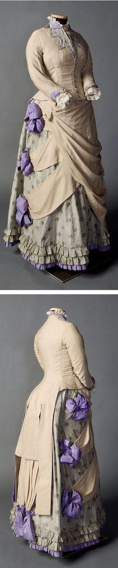 """Two piece day ensemble in beige, pale green, and purple, ca. 1882-1885, This day outfit, from the late bustle era, was worn by Kate Morris Cone, a student in the first graduating class of Smith College in 1879. The fawn wool bodice is cut in a """"tailor-made"""" style, tightly fitted with an obvious CF button closure, long cuffed sleeves and an elaborate tail, all to suggest a man's tail coat."""