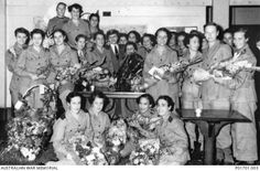 Group portrait of Australian Army Nursing Service (AANS) nurses, who were former prisoners of war (POWs), on board the hospital ship Manunda on its arrival in Australia - 18th October, 1945.   Most of the group were staff members of the 2/10th and 2/13th Australian General Hospital (2/10AGH and 2/13AGH) and the 2/4th Casualty Clearing Station (2/4CCS).