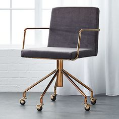 Rouka Office Chair ($299; steel frame in brushed brass), CB2.