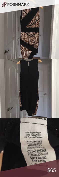 Guess Gold Glitter and Black Dress Amazing gold sequin asymmetrical dress! Size large, 65% reyon, 30% nylon, 5% spandex. Perfect comfy fit, material is thick so it doesn't show everything. Worn once, no rips, stains or snags. Perfect for holidays, parties, Christmas and New Years! Guess Dresses Mini