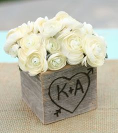 Like the wooden box with initials, would have much brighter/prettier flowers though