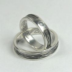 Bound - custom made wedding rings (the one for her with faceted aquamarine) - by Anna Rei