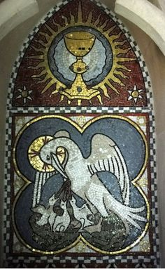 A mosaic of Pelican in Her Piety under the Holy Grail is found on the south wall.