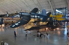 I want a  Steven F. Udvar-Hazy Center: Vought F4U-1D Corsair, with P-40 Warhawk and SR-71 Blackbird in background / http://www.holidaygoodness.com/steven-f-udvar-hazy-center-vought-f4u-1d-corsair-with-p-40-warhawk-and-sr-71-blackbird-in-background/