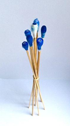 blue buds standing tall