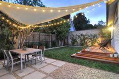 West Hollywood back yard Redwood platform deck, gravel / square paver patio, sail shade, string lights & l