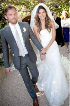 Groom in gray suit and groomsmen in vests...