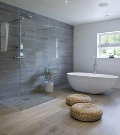 make the shower a double and take the out the totally necessary poufs and this bathroom would be lovely