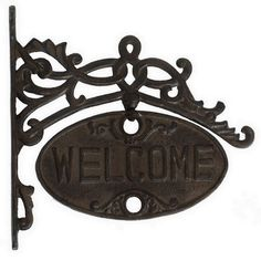 HOME DECOR – HARDWARE – Every visitor will be greeted with charm and cheer upon seeing this Welcome Wall Sign. The cast iron adds pleasant contrast to the curving scrolls of this warm greeting.   Product: 1 Sign   Color: Brown   Construction Material: Cast Iron Features:   Pre-drilled holes for installation Hardware not included    Dimensions: 11.25 H x 1.25 W x 11 D