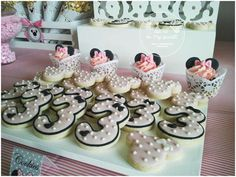 Cupcakes and cookies at a Minnie Mouse birthday party! See more party planning ideas at CatchMyParty.com!