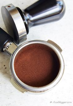 A comprehensive guide on how to make espresso at home like a pro. Homemade espresso will cost you 10 times less and will rival best espressos out there. Tamped coffee.