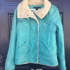 Teal blue Marc Jacobs fur coat Oh my! This coat is truly stunning. The color is so beautiful. Purchased at Saks in NY a few years ago. In excellent used condition. Lined with fur, making it super warm. The neck can be buttoned up too to keep the cold out. Marc Jacobs logo on the buttons. 4 front pockets. Thanks for looking. Marc Jacobs Jackets & Coats Puffers