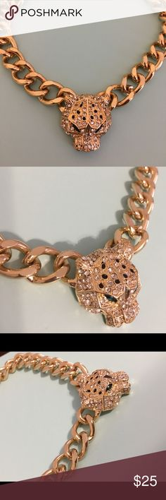 Cartier inspired panther pendant gold chain Gold metal chain with panther head pendant. Pendant detailed with white rhinestones and green rhinestone eyes. Excellent condition, and great quality for costume jewelry. Inspired by high end, designer pieces. Jewelry Necklaces