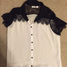 Sheer Lacey blouse with buttons Sleeves and neck area is black with lace rest is white, sheer, only worn once Cato Tops Blouses