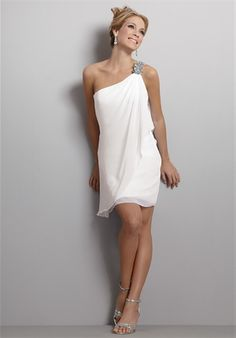 Gown features draping and beading.