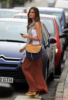 Rust colored, pleated, long skirt; tank; and gray scarf with wedge sandels
