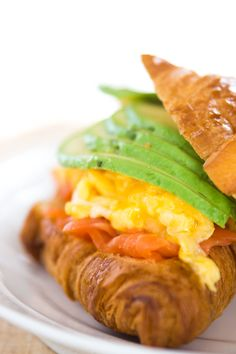 Avocado, Smoked Salmon, and Scrambled Egg Croissant Sandwich.