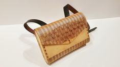 """Parametric Wood Purse in 1/8"""" birch plywood with linseed oil finish and leather strap."""